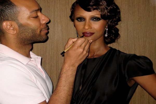 Makeup artist Sam Fine and model Iman