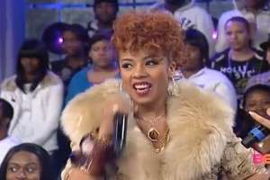 Keyshia Cole wearing pink leopard Violent Lips on 106 & Park