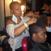 Celebrity Stylist Felicia Leatherwood demonstrating a natural updo hairstyle using Shea Moisture products