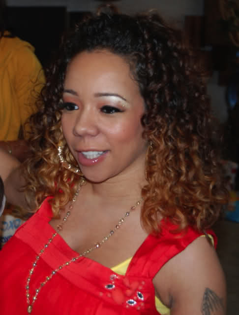 "look at some of our favorite hairstyles from Tameka ""Tiny"" Harris"