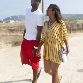 Gabrielle Union vacays with boyfriend, D-Wade, in a Honey Gold swim cover.