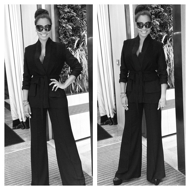 La La Anthony on set filming in her all-black attire. Loving the wide leg pants!
