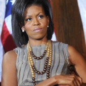 Looking every so chic, Michelle Obama layered her dipped pearls perfectly with a simple diamond earrings.