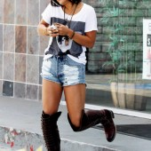 Selena Gomez shorts and tall boots
