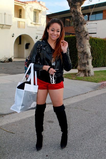 Raven Symone shorts and tall boots