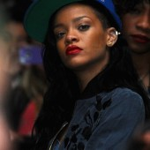 Rihanna hangs out at Coachella in her sporty get-up with red lips.