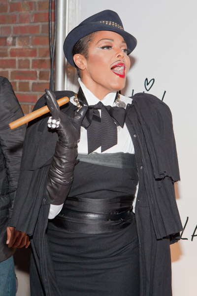 Janet Jackson turns mobster with her cigar in hand.
