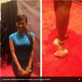 Denyce Lawton shows off her shoes at the Hip Hop Inaugural Ball