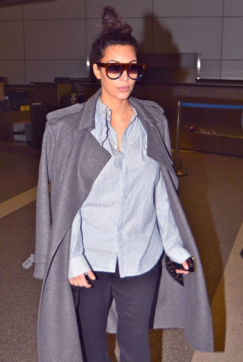 f932d5bfce9b Kim Kardashian lives in the airport. She was spotted at LAX Airport in a  stripe button-front shirt