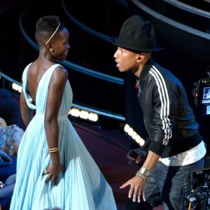 Pharrell Williams gets 'Happy' with Lupita Nyong'o during Oscar performance