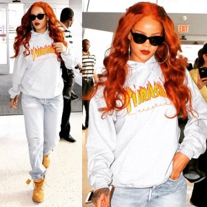 Rihanna turns up the heat with flame-red hair